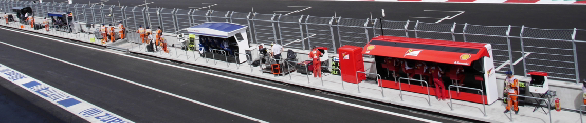 Pit wall: Completes requirements of motorsport circuits