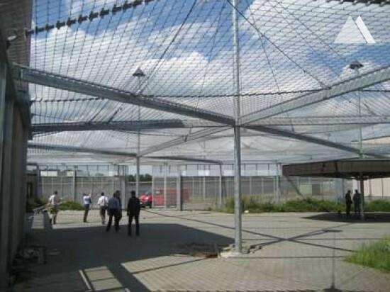 Net canopy over prison inner yards 2009 - Geobrugg